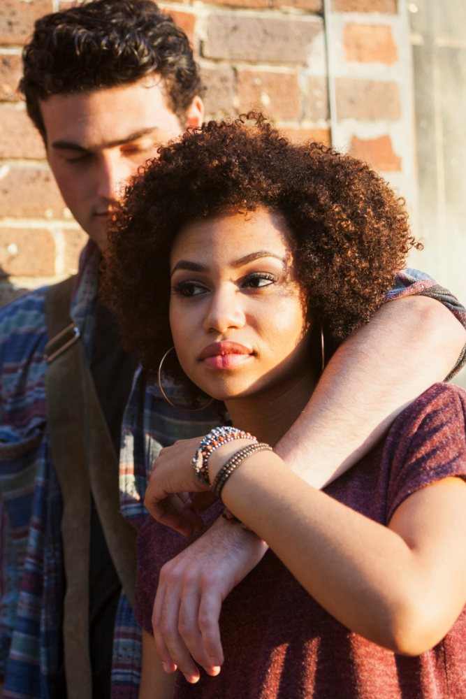 Relationship Advice: Five Tips for Dating in Your 30s and Beyond (Image of a woman with short curly hair next to a man whose arm is wrapped around her shoulder.)