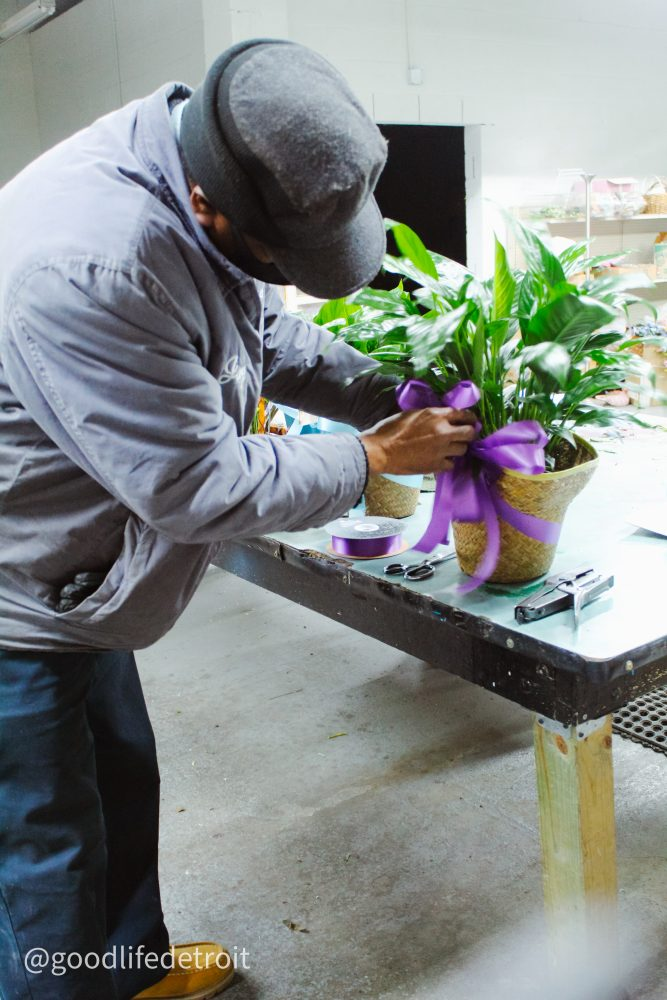 Mr. Jay Smith working on a plant arrangment for a customer.