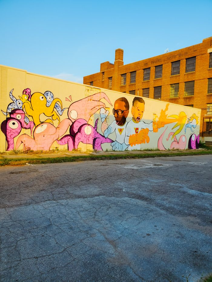 """Artist Tylonn Sawyer painted this cool mural """"Ron Incredible and Chan Man save Detroit!"""" Mural is located at 2881 E. Grand Blvd. in Detroit's North End neighborhood."""