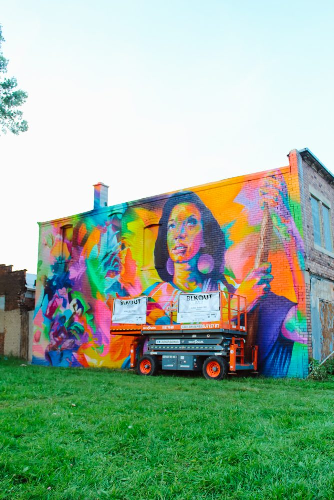 """Thomas """"Detour303"""" Evans painted a beautiful mural in Detroit, Michigan for the BLKOUT Walls Festival."""