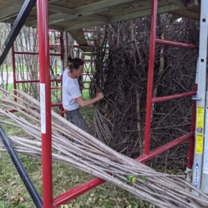 A volunteer helps with the 'Stickwork' art project in Detroit.