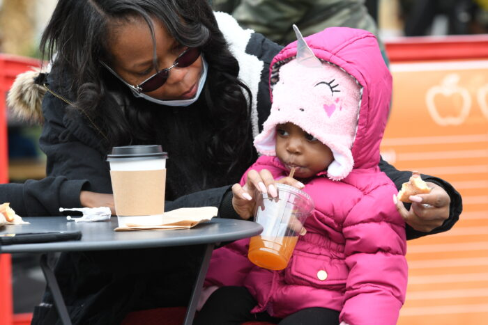 A mother and her daughter enjoy Cider in the City at Beacon Park in Downtown Detroit.