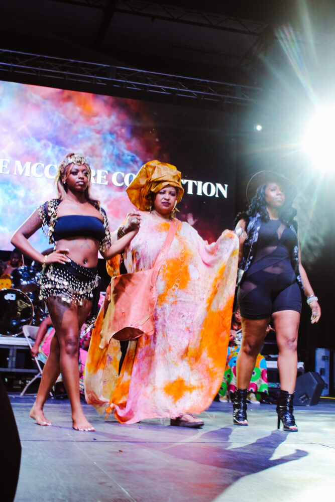 Three models walk the runway wearing designs by The McClure Collection at the Detroit Rocks the Runway Fashion Show (August 2021).