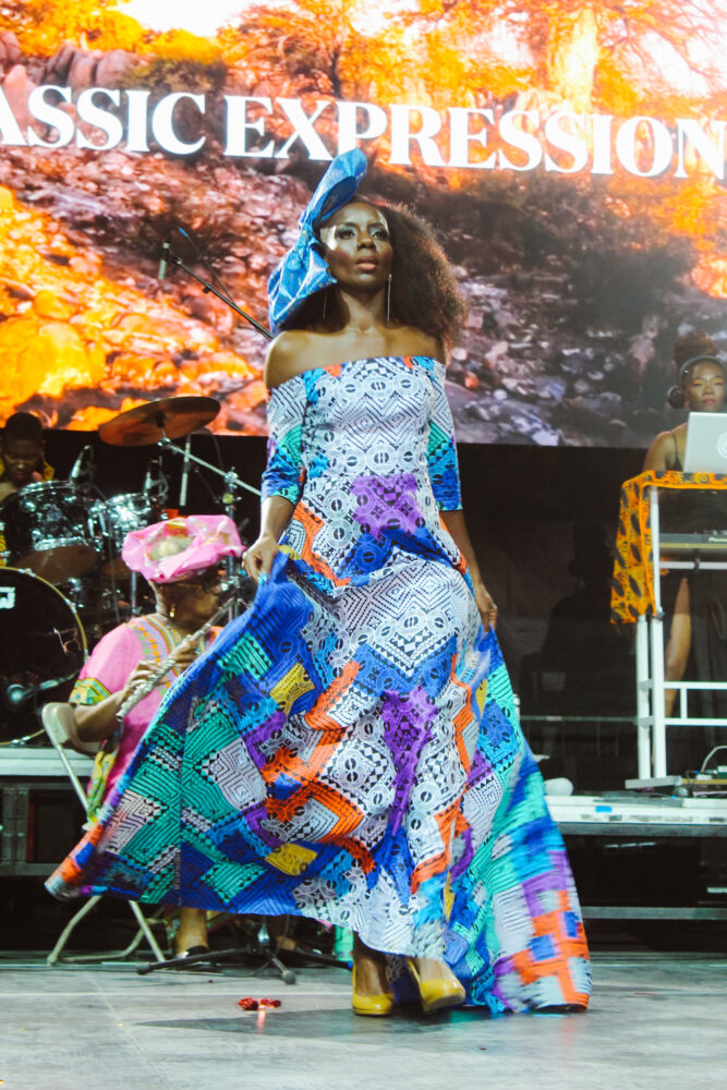 Detroit Rocks the Runway fashion model walks the runway wearing a beautiful, multicolored design by Classic Expressions. (August 2021)