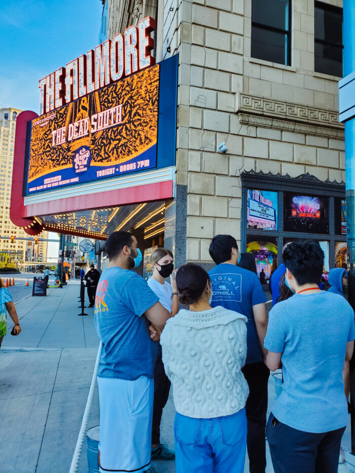 Customers nearing Mom's Spaghetti restaurant. The Fillmore Detroit is in the background.